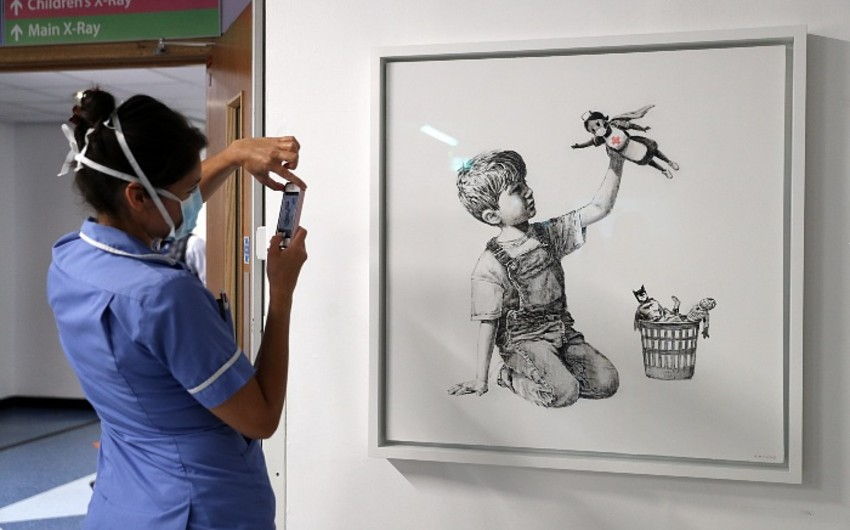 Banksy to auction painting drawn in hospital