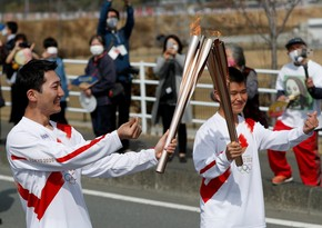 Tokyo Olympic torch relay starts in Japan amid pandemic curbs