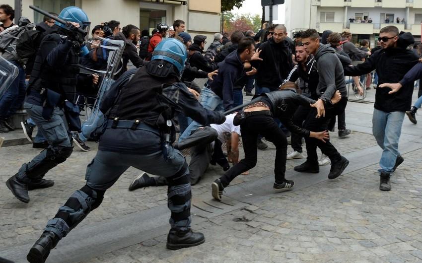 Turində polislə anti-qlobalçılar arasında qarşıdurma zamanı 11 nəfər xəsarət alıb
