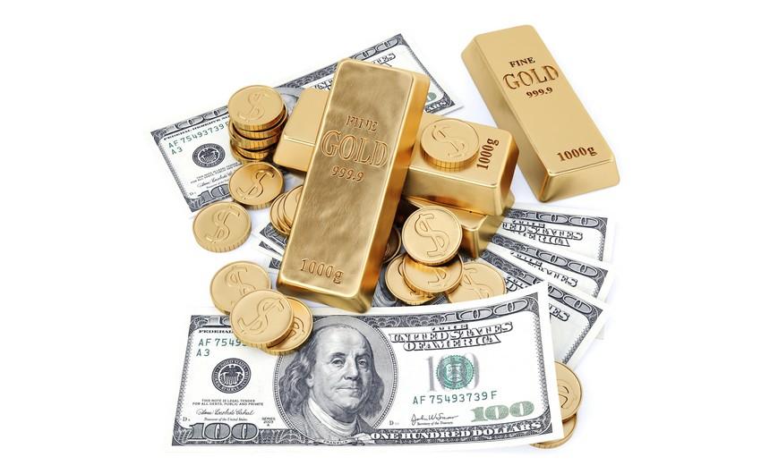 Gold rises as U.S. dollar retreat