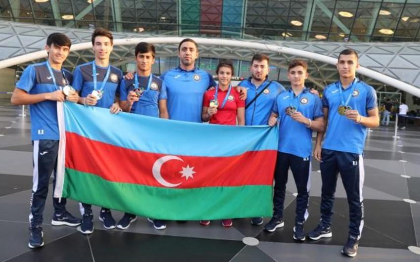 Avropa birinciliyində qızıl medal qazanan cüdoçular Bakıya qayıdıb