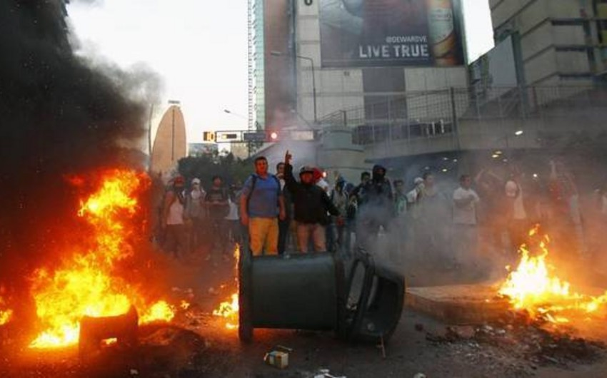 Caracas witnesses new clashes, accompanied by explosions, amid protests -VIDEO - PHOTO