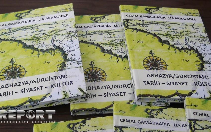 Tbilisidə işğal altında olan ərazilərdə abidələrin dağıdılmasından bəhs edən kitabın təqdimatı olub - FOTO