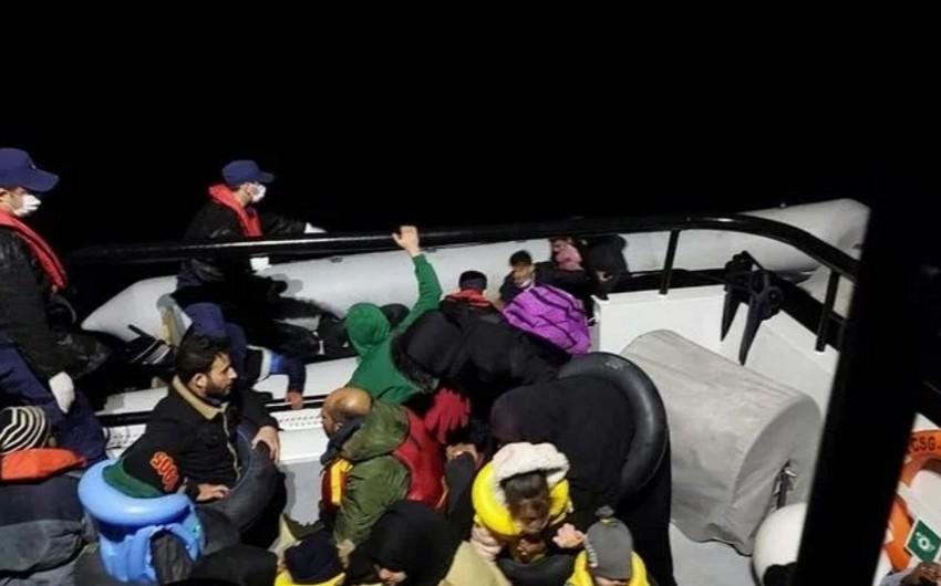 Turkish coast guard rescues dozens of migrants