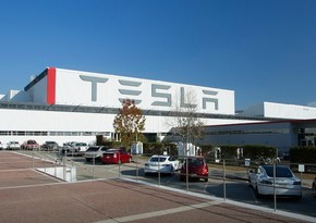 Tesla records first-ever full-year profit