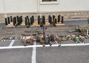 Police officers find weapons abandoned by Armenians in Fuzuli