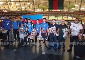 Azerbaijani medalists return home