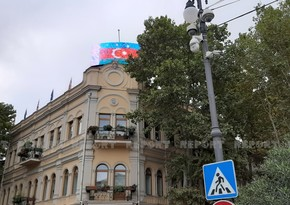 Azerbaijani flag displayed on monitors in Tbilisi