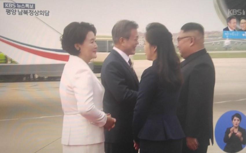 Kim Çen In Cənubi Koreya prezidentini hava limanında özü qarşılayıb - VİDEO