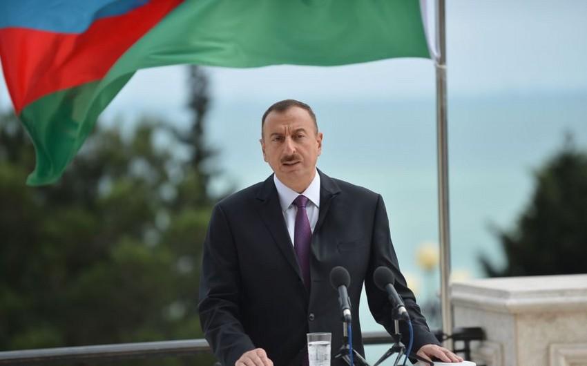 Prezident İlham Əliyev olimpiya çempionu olan Radik İsayevi təbrik edib