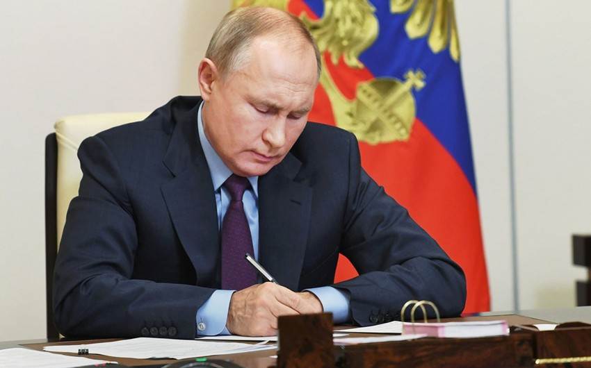 Putin signs law allowing him to put forward candidacy for presidential elections