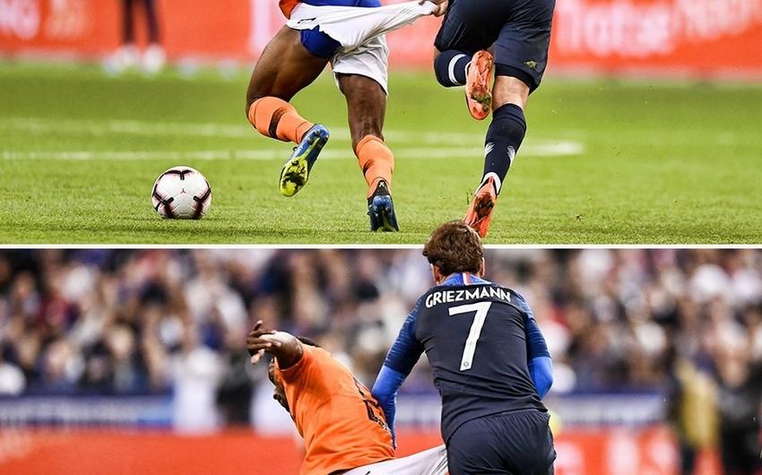 Qrizmann oyun zamanı hollandiyalı futbolçunun şortunu dartaraq cırıb