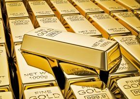 Золото дешевеет из-за роста курса доллара
