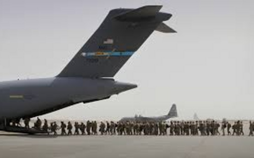 NATO troops end one Afghanistan mission, start another