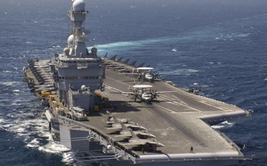 Pentagon chief makes first visit to France's Charles de Gaulle aircraft carrier in the Gulf