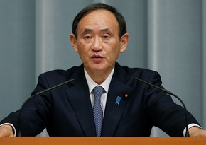 Japan PM apologizes for son's dinner with officials
