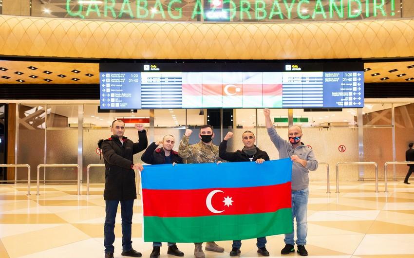Four veterans sent by YASHAT to Turkey return to Azerbaijan