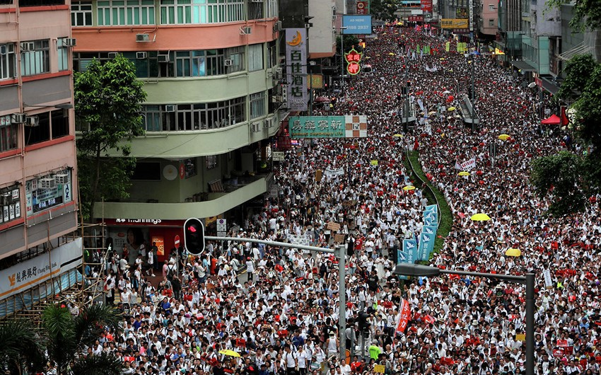 Hong Kong police disperse demonstrators with tear gas