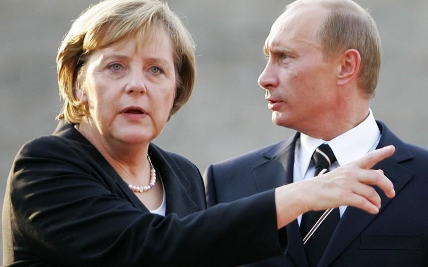 Putin və Merkel Suriyada yaranmış vəziyyəti müzakirə ediblər