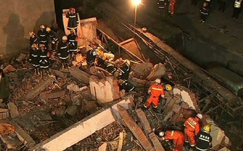 Çində bina uçub: 17 ölü və 23 yaralı