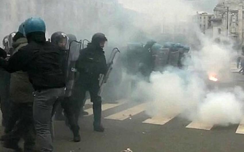 Milanda miqrantlarla polis arasında toqquşma baş verib