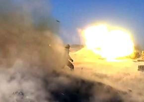 Launching rocket and artillery strikes against enemy positions