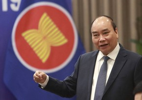 Vietnam's Parliament elects Prime Minister Phuc as new president