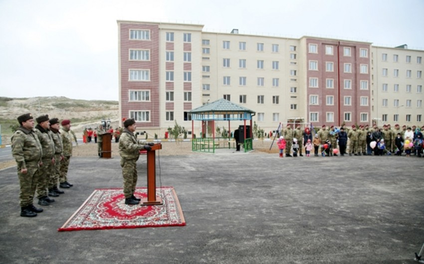 Opening ceremony of new residential building at another military unit was held