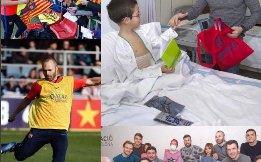 Barselonanın futbolçuları xəstə uşaqlara baş çəkiblər