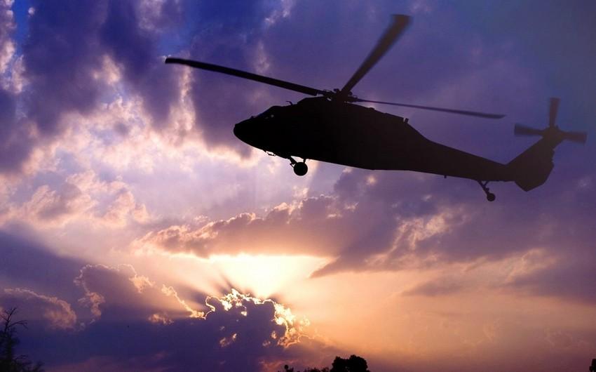 Çində helikopter qəzası olub, ölənlər var