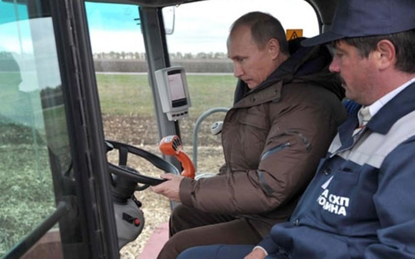 Путин пошутил о готовности пойти работать комбайнёром