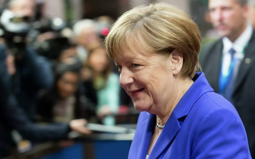 Gold coins with Merkel's portrait on sale in Germany