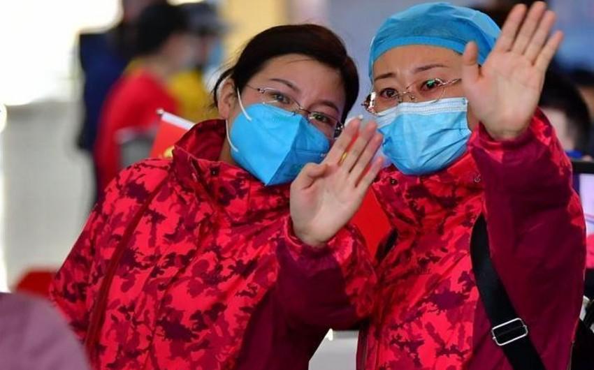 Koronavirusun tüğyan etdiyi şəhərə minlərlə tibb işcisi göndərildi