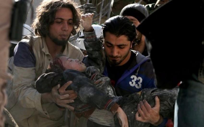 KİV: Rusiya Suriyanın ərazilərini 138 dəfə bombalayıb, 17-si uşaq olmaqla 93 dinc sakin ölüb