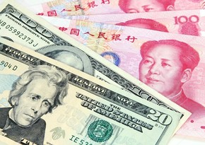 People's Bank of China strengthens yuan against dollar