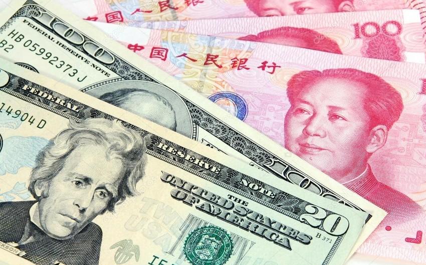 Центробанк Китая укрепил курс юаня к доллару