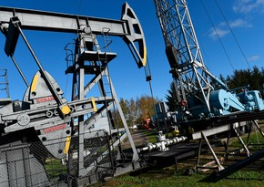 Oil companies in Europe and US  write down $145 billion in assets