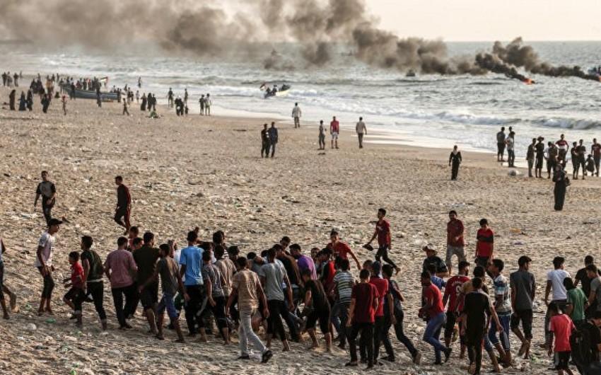 İsrail hərbçiləri ilə toqquşmalarda 5 fələstinli ölüb, 85 nəfər yaralanıb