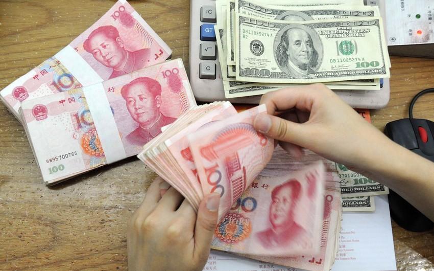 Çində dolların məzənnəsi 7 yuana yaxınlaşıb