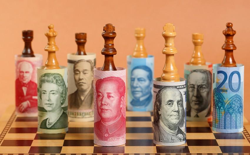 Valyuta müharibələri: dollar bazardakı mövqeyini gücləndirəcəkmi?