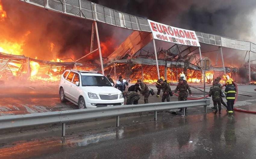 С пожара на территории рынка стройматериалов EuroHome - ФОТОРЕПОРТАЖ