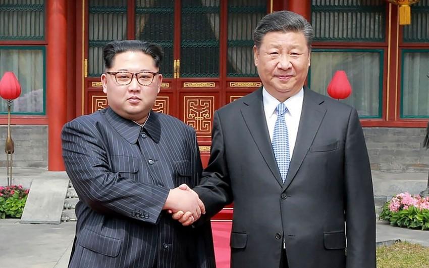 KXDR lideri Çinin dövlət başçısı ilə Koreya yarımadasının nüvə silahlarından təmizlənməsi məsələsini müzakirə edib