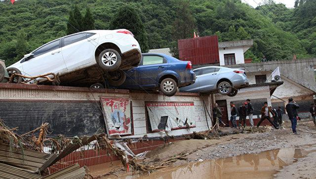 At least 30 killed in floods and heavy rain in China