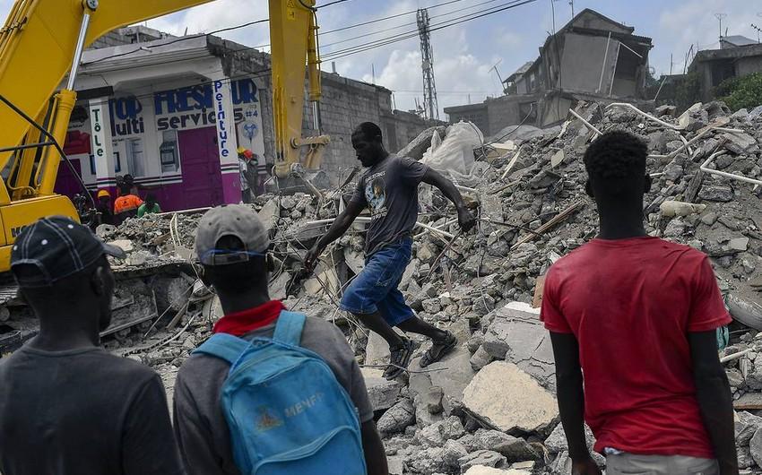 Death toll in Haiti earthquake grows to 2,248