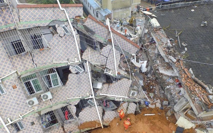 Çində bir neçə yaşayış binası uçub