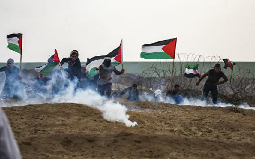 Qəzzada İsrail hərbçiləri ilə toqquşmalarda onlarla fələstinli yaralanıb