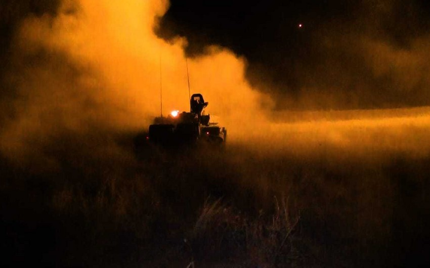 Combat firing conducted at night in course of large-scale exercises