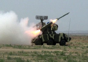 Anti-aircraft missile units conduct live-fire tactical exercises