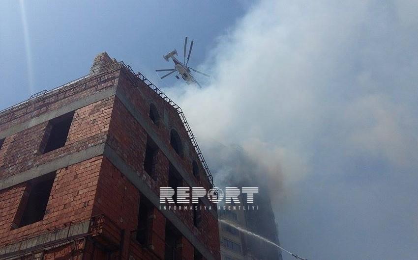 Hündürmərtəbəli binada baş verən yanğının söndürülməsinə 7 helikopter cəlb olunub - VİDEO