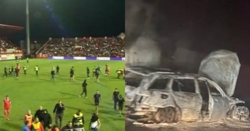 Futbol matçında azarkeşlər meydana girib, referinin avtomobili yandırılıb